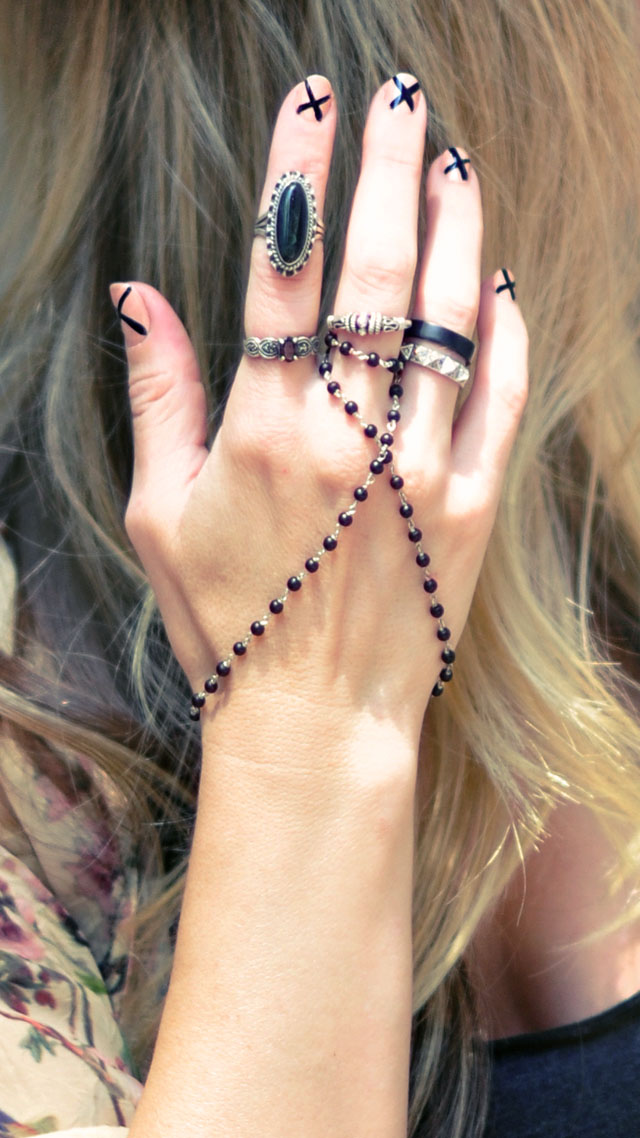 1 nude and black nails with x's