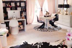 home office with ikea expedit desk shelving unit, grey walls, pink curtains, cowhide rug, bloggers offices
