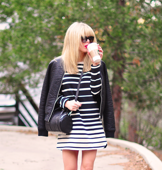 black and white striped dress, red lips, leather bomber jacket