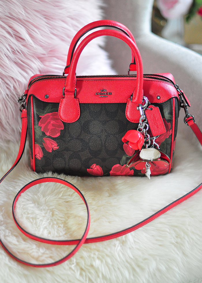 Coach logo bag with red roses and leather accents