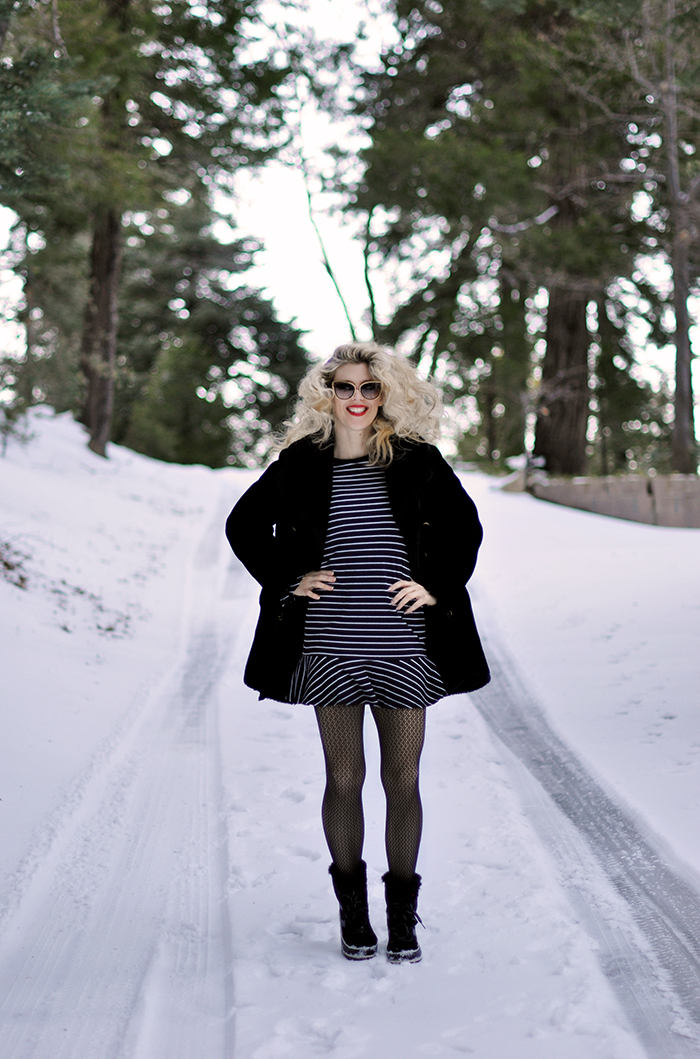 black striped dress in the snow-snow style-fishnets-sorel snow boots