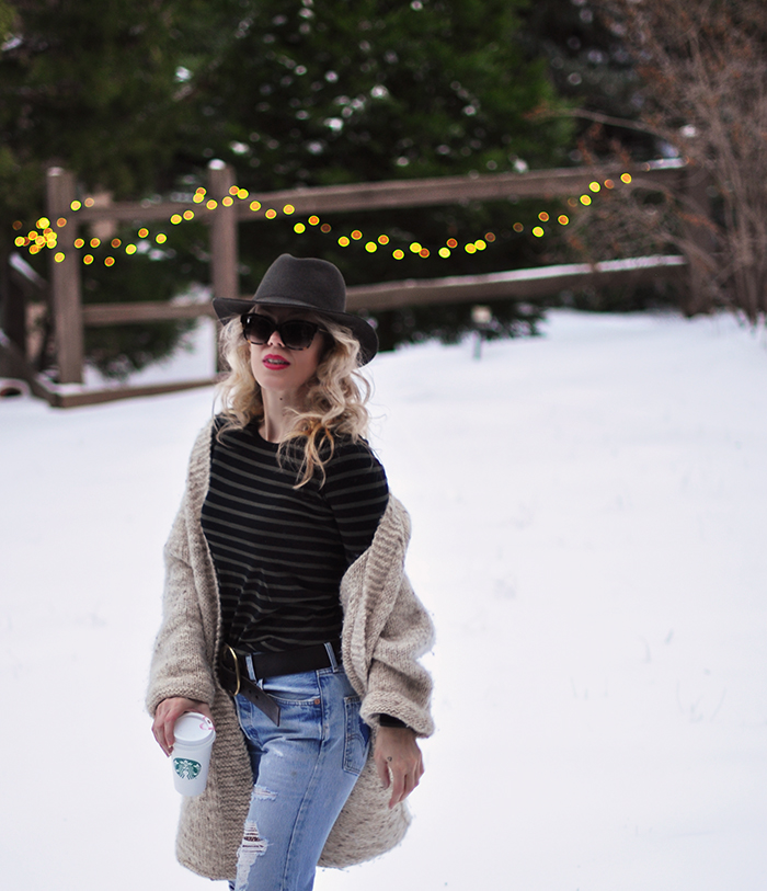 snow style, vintage levi's with fishnets, oversized cardigan, striped tee, wool fedora