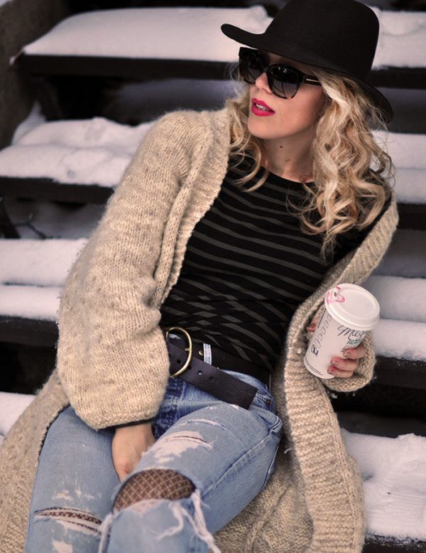 casual style in the snow-oversized cardigan-vintage levis-striped long sleeve tee-hat-red lips