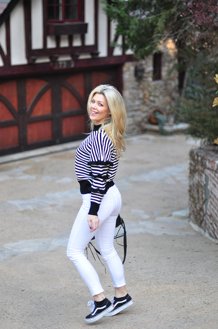 black and white outfit-striped sweater, white jeans, vans