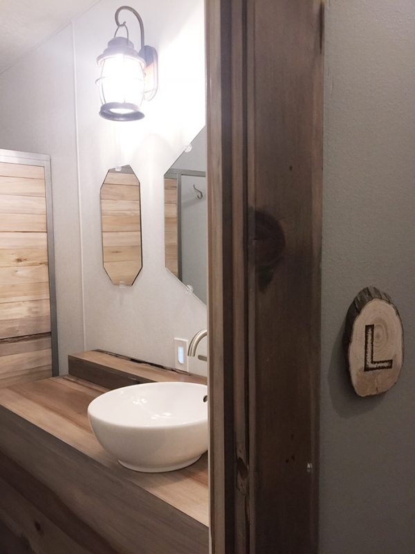 rustic modern ladies public restroom - dogwood tavern