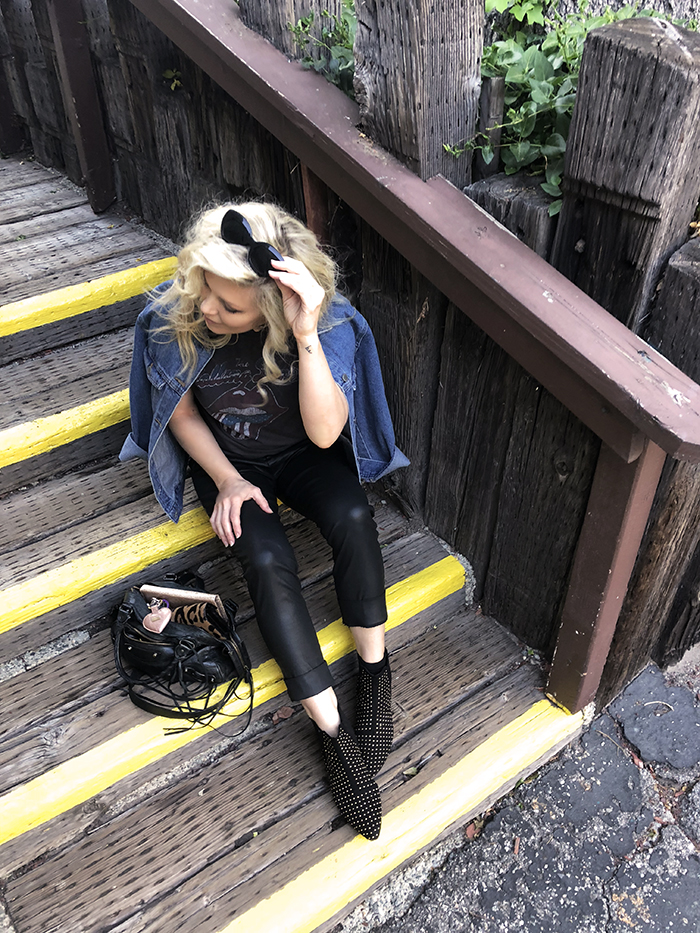 faux leather pants-studded boots-rocker tee-yellow stripe steps