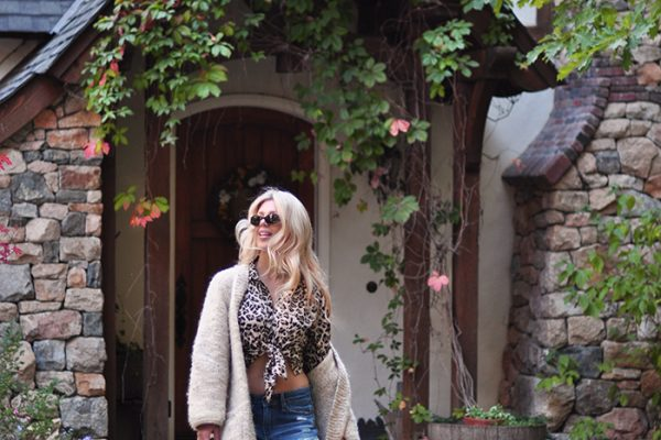 storybook house-boyfriend jeans -tied up leopard blouse-oversized cardigan-lace up flats-trotters shoes