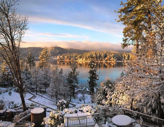 snowing on the lake in lake arrowhead waterfront home