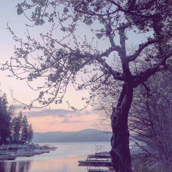 snow dusting over lake arrowhead sunset