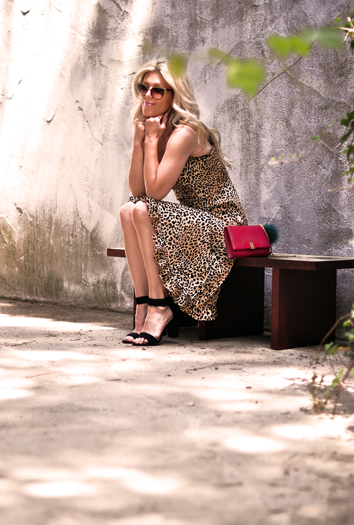 leopard slip dress with red bag and ankle strap heels - love maegan tintari