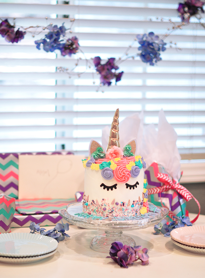 Unicorn cake with rainbow filling - little girls unicorn party ideas
