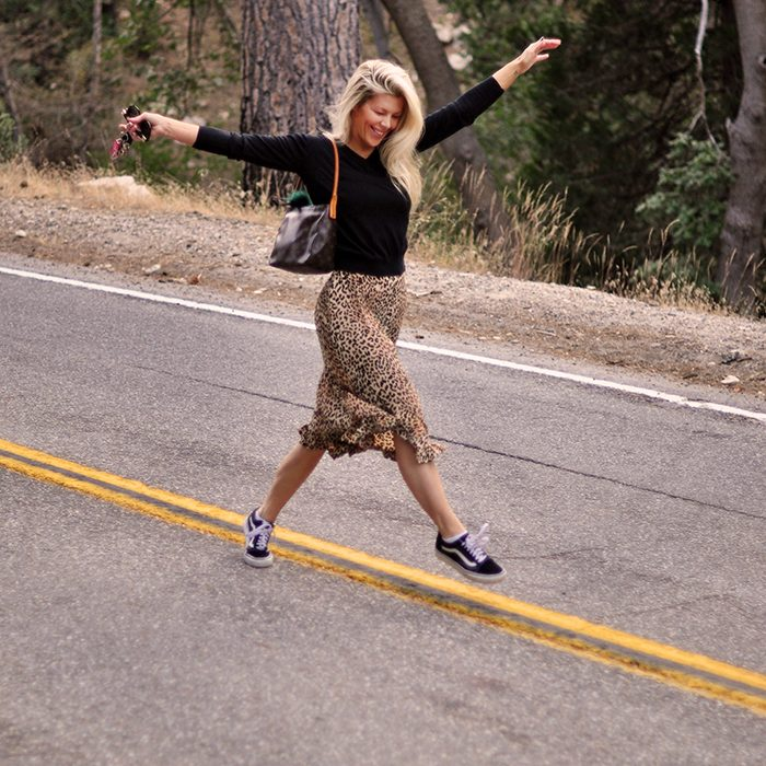 walkig the line-leopard skirt and sweater and sneakers
