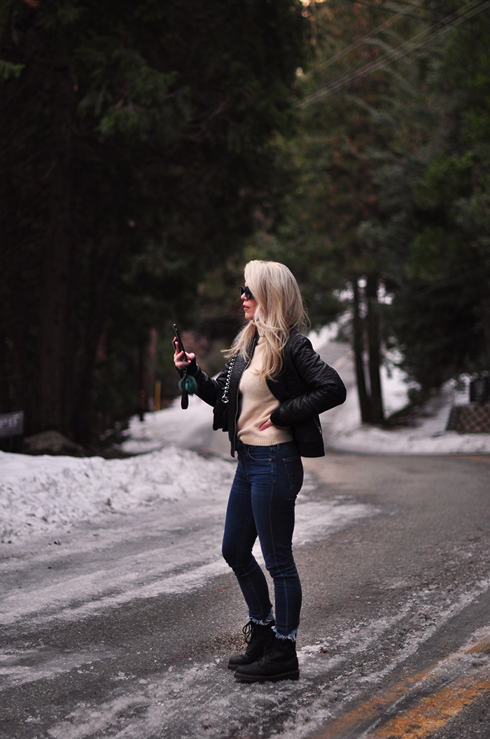 winter outfits in the snow with dr martens boots and jeans