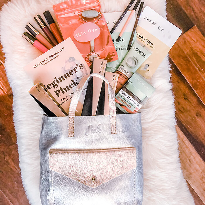 love Maegan blogger giveaway - leather bag-book-makeup-beauty products