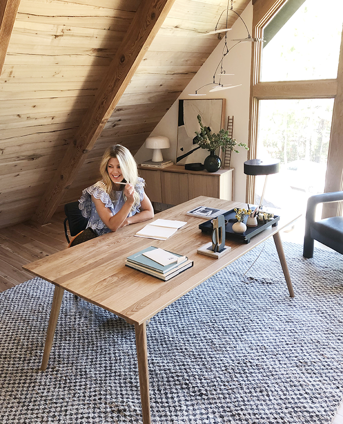 sitting at desk-mid century modern mountain house office