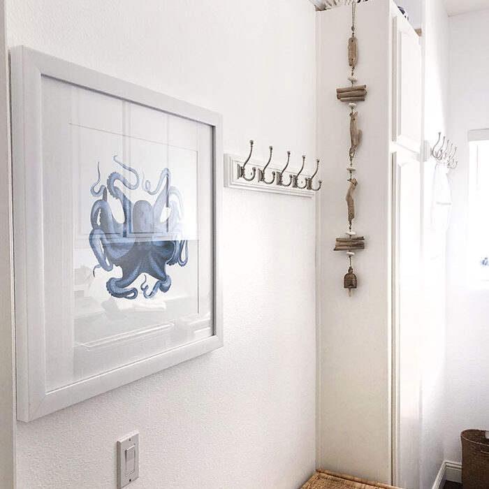 light and airy clean white laundry room with nautical beach decor