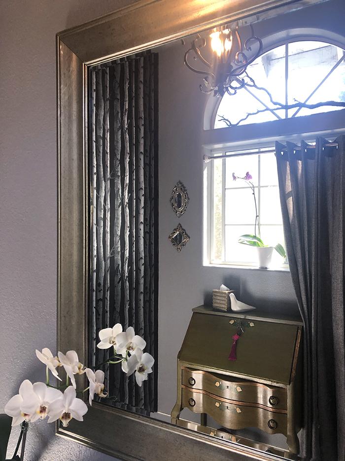 dark bathroom decor, tree-lined wallpaper, grey walls-large windows, high ceilings