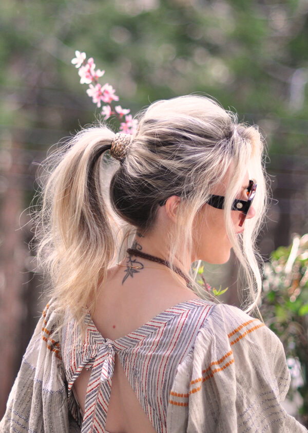 how to wrap your ponytail base with braids to disguise your hair ties