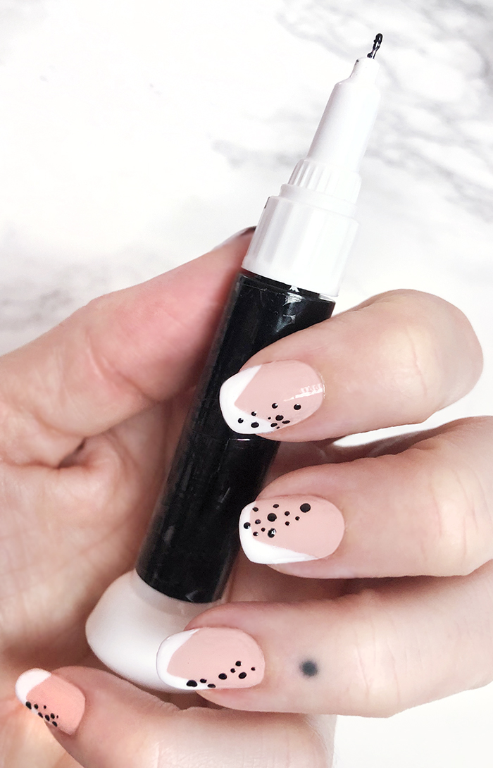 abstract french tip manicure with dots - neutral nail art