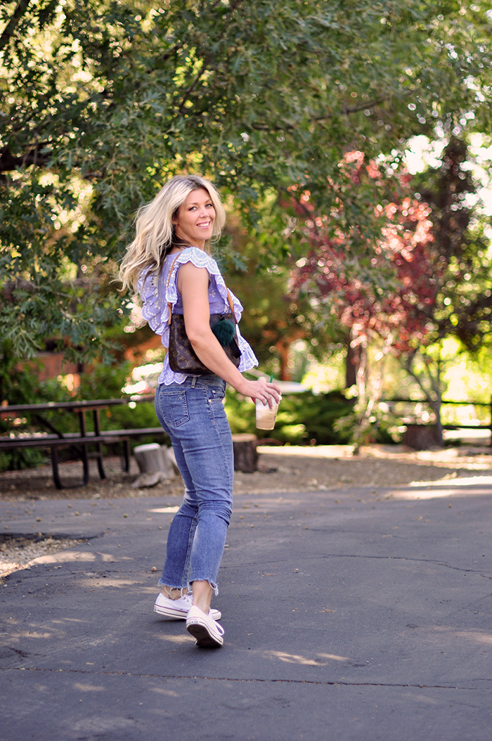 cute summer outfit - jeans and a cute ruffled top with converse sneakers