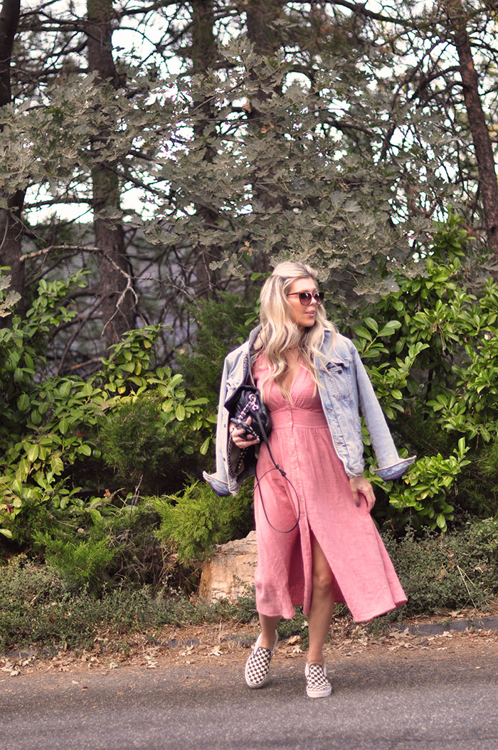 blush pink dress with denim jacket and sneakers