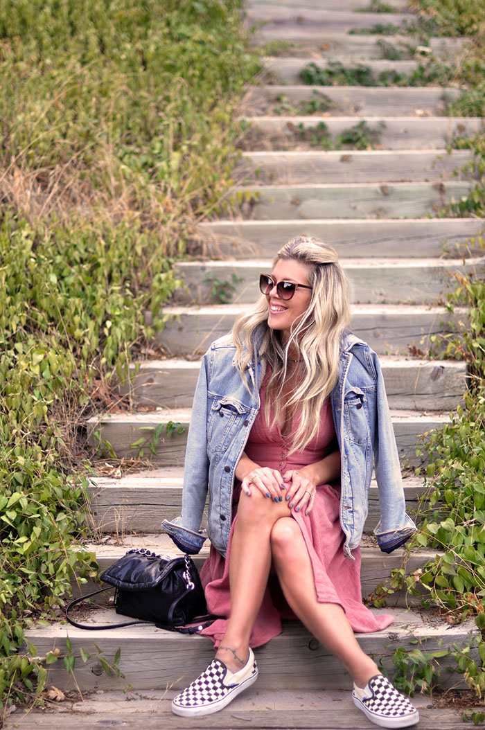 pink midi button up dress with denim jacket and checkered vans