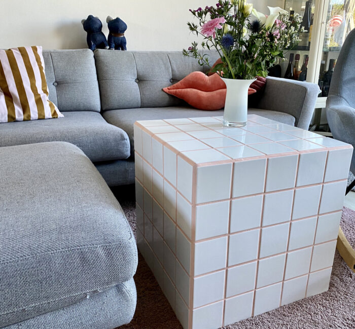 white tiled cube side table with pink grout