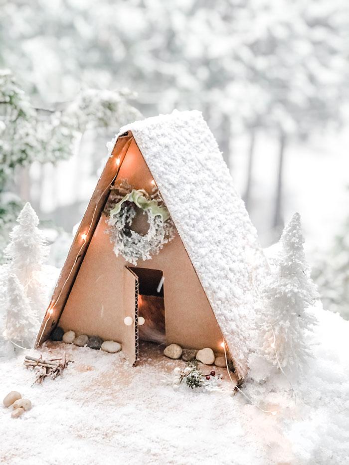 DIY mini a-frame winter cabin in the snow