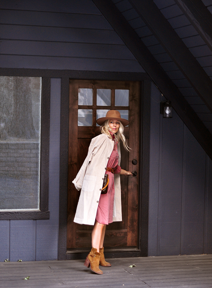 fall style, dusty rose pink dress and boots, dark a-frame house
