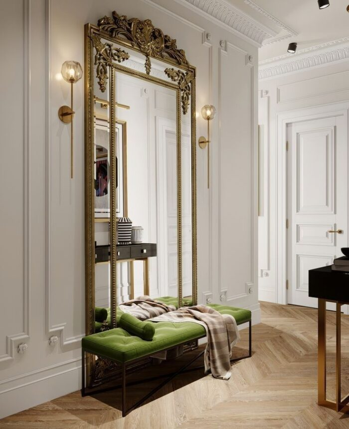 large entry mirror with gold frame and bench