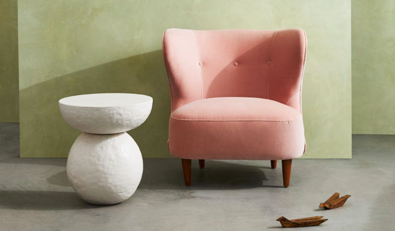 pink chair and stone accent table