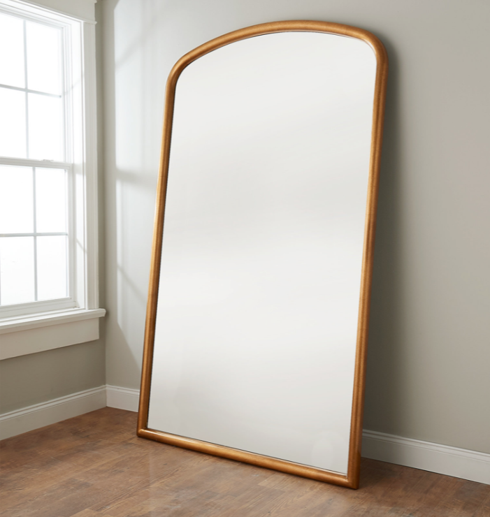 large arched floor mirror