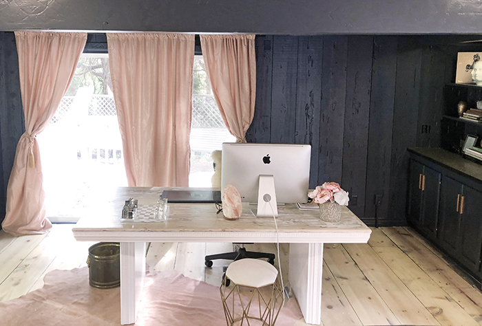 pretty office space, dark blue walls blush pink curtains, blogger offices