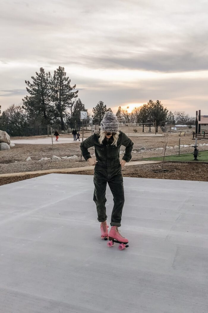 roller skating at sunset in lake arrowhead on pink moxi lolly roller skates and corduroy lee coveralls in the winter