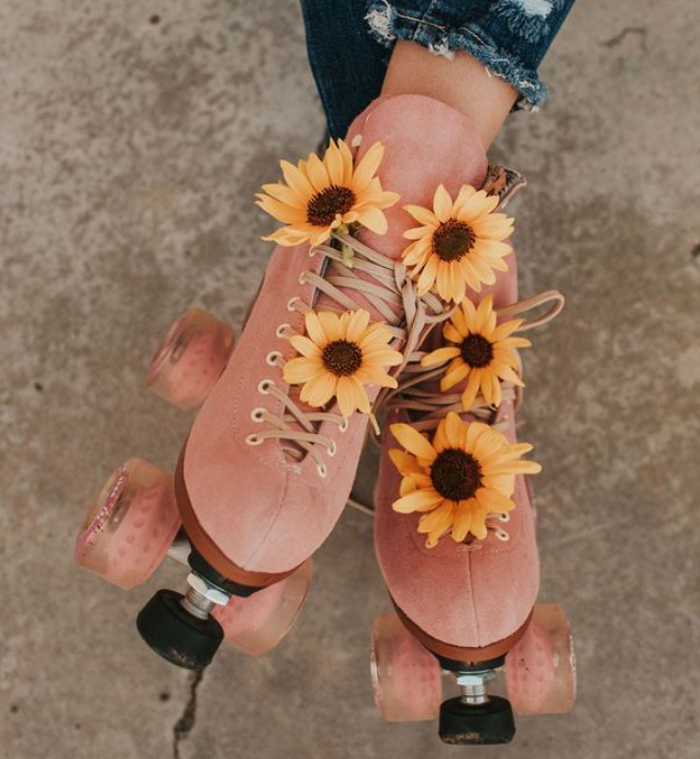pink suede roller skates with sunflowers - moxi skates