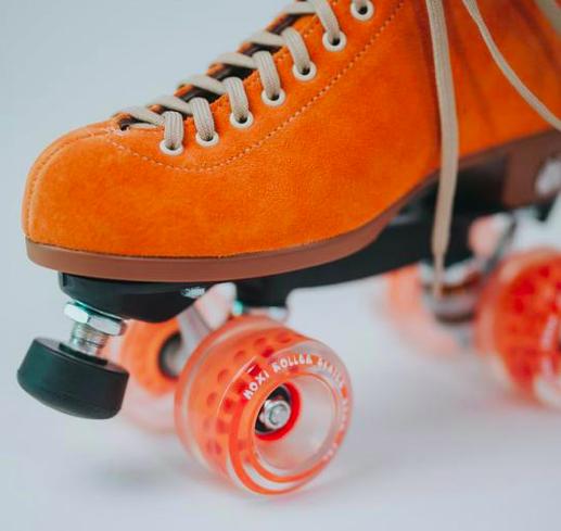 moxi roller skates in clementine and orange wheels