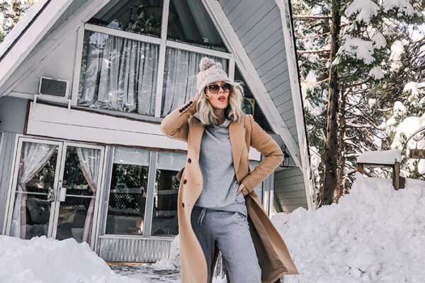 grey sweat suit with camel coat-snow in lake arrowhead-a-frame cabin-love maegan winter style