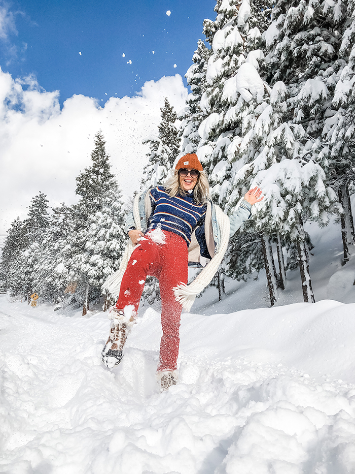 retro winter style, striped turtleneck, rust red pants, outfits in the snow, lake arrowhead, snow days, what to wear in the snow, kicking the snow photo