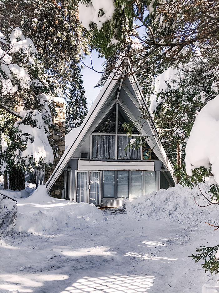 a-frame cabin in the snow in lake arrowhead, love maegan's office