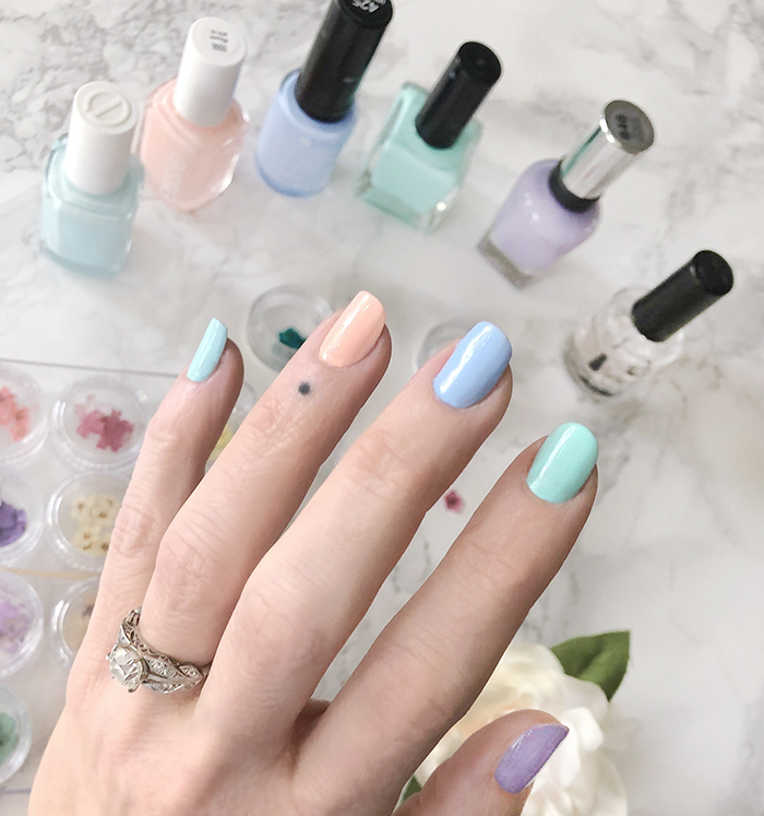 pastel nail art manicure with flower accent nails