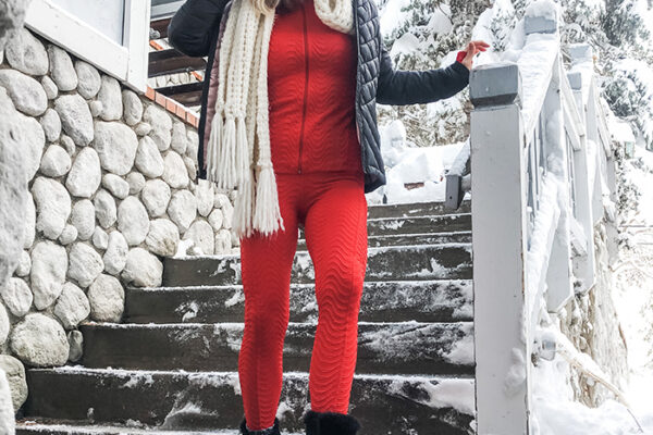 red leggings and jacket set with black sorel snow boots and accessories in the snow