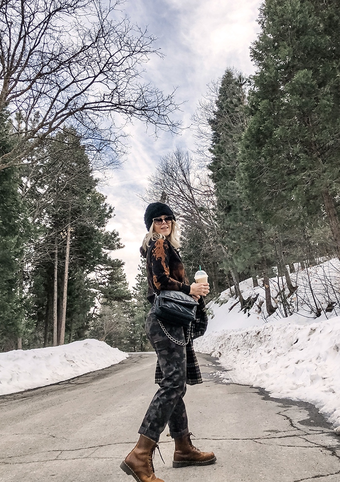 winter outfit in the snow in lake arrowhead, camo pants, bleach dye tie dyed black hoodie sweatshirt, black beanie, docs, outfit with dr martens, lake arrowhead snow