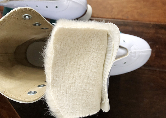 DIY Faux fur roller skate lining, how to get your skates to fit better when they're too big, white retro roller skates with teal bont wheels and derby laces