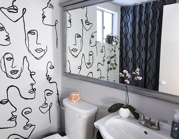 before and after small bathroom makeover with hand painted wall line art faces on the wall, wall paper alternative, drawing on walls, wall mural, accent walls, budget bathroom makeover