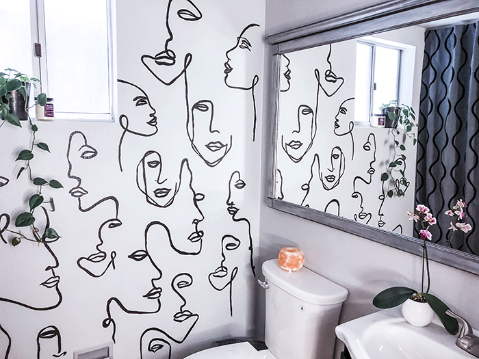 before and after small bathroom makeover with hand painted wall line art faces on the wall, wall paper alternative, drawing on walls, wall mural, accent wall