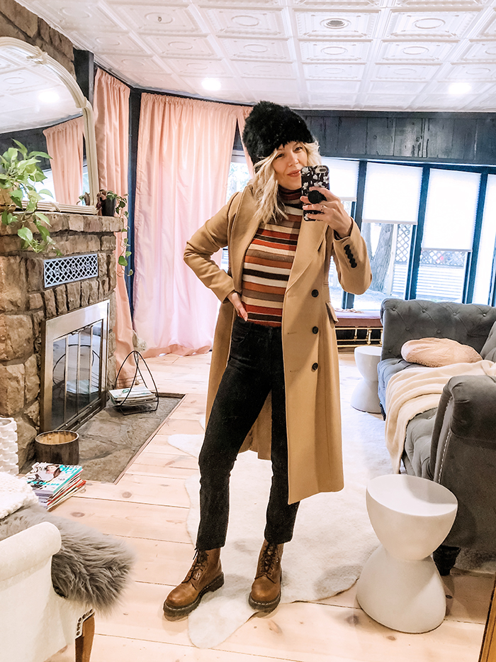 striped turtleneck sweater and black jeans and camel coat