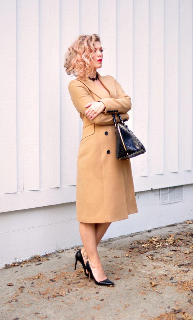 vintage black slip dress with camel coat and heels