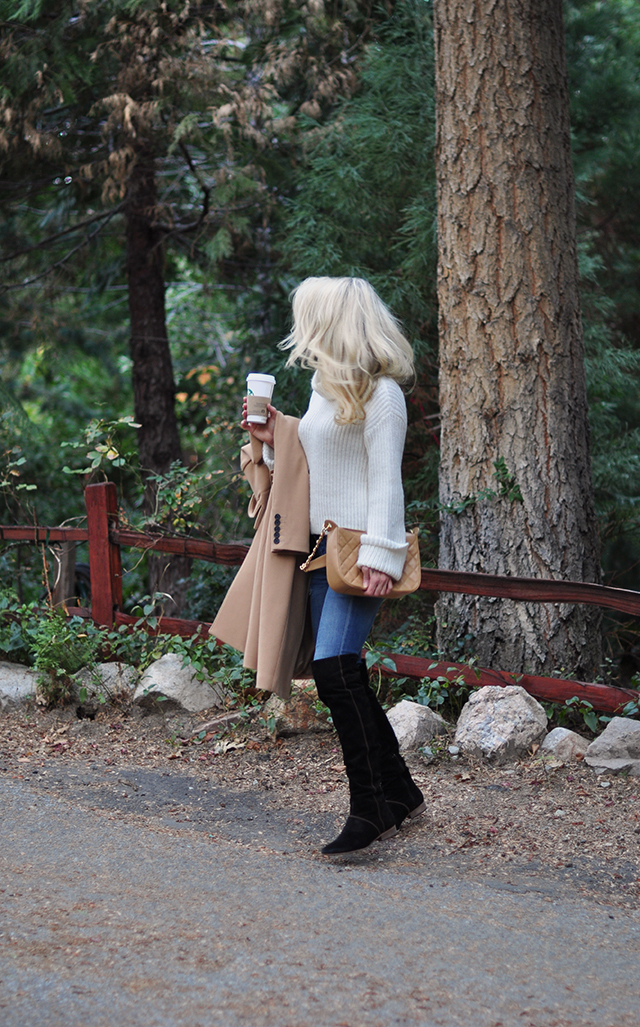 jeans and over the knee boots with an oversize turtleneck and camel coat