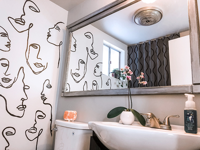 before and after small bathroom makeover with hand painted wall line art faces on the wall, wall paper alternative, drawing on walls, wall mural, accent walls