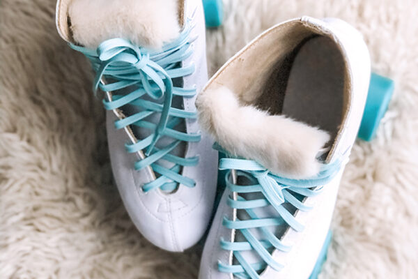 retro white skates with fur tongue-aqua laces and teal wheels